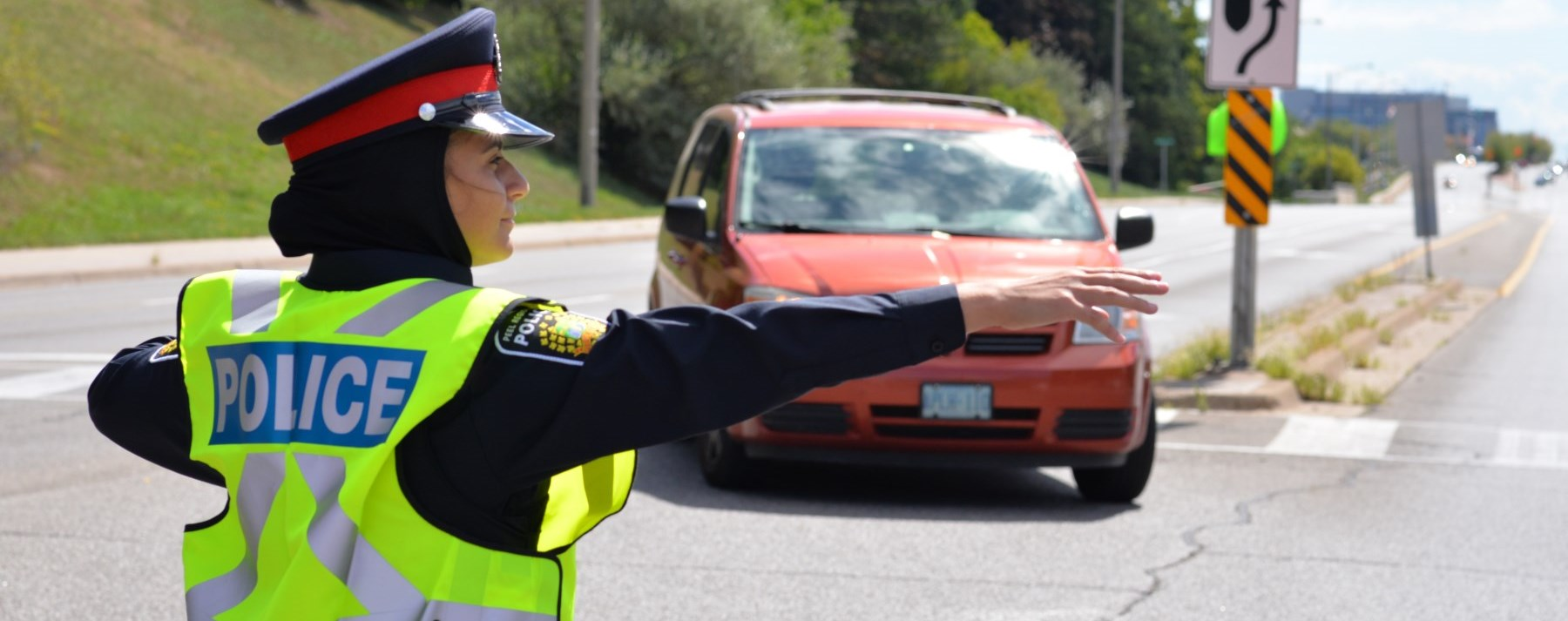female officer directing traffic