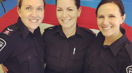 female officers smiling at camera