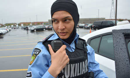 Female Auxiliary Officer answering a call